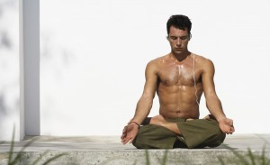 Man with headphones in yoga position